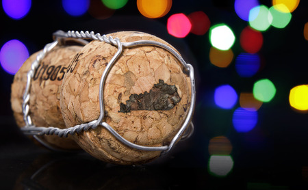 Champagne cork with the shape of Kentucky burnt in and colorful blurry lights in the background.(series) Stock Photo