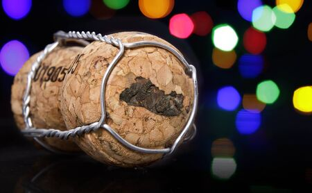 mapa de el salvador: Champagne cork with the shape of El Salvador burnt in and colorful blurry lights in the background.(series)
