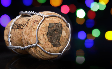 Champagne cork with the shape of Sudan burnt in and colorful blurry lights in the background.(series)