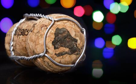 Champagne cork with the shape of Senegal burnt in and colorful blurry lights in the background.(series)