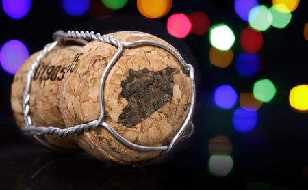 Champagne cork with the shape of Syria burnt in and colorful blurry lights in the background.(series)