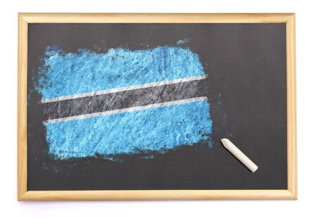 botswanan: Blackboard with the national flag of Botswana drawn on and a chalk.(series) Stock Photo