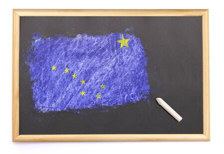 Blackboard with the national flag of Alaska drawn on and a chalk.(series)