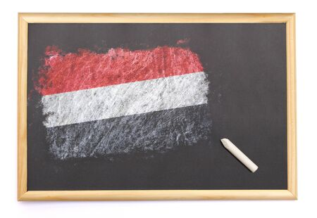 Blackboard with the national flag of Yemen drawn on and a chalk.(series)