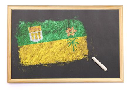 saskatchewan flag: Blackboard with the national flag of Saskatchewan drawn on and a chalk.(series)
