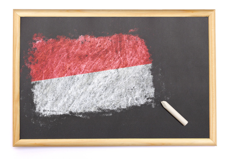 Blackboard with the national flag of Indonesia drawn on and a chalk.(series) Banque d'images