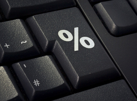 Return key of a black keyboard with the shape of a percent symbol imprinted .(series) Banque d'images