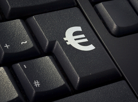 imprinted: Return key of a black keyboard with the shape of an Euro symbol imprinted .(series)