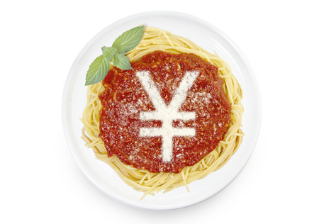 Freshly cooked dish of tasty pasta with tomato sauce and parmesan cheese in the shape of a Yen or Yuan symbol .(series) Stock Photo