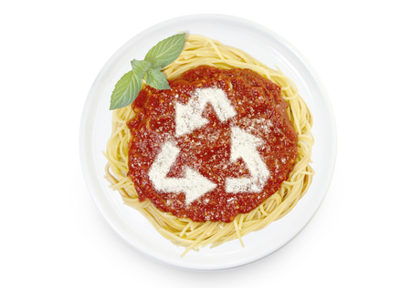 Freshly cooked dish of tasty pasta with tomato sauce and parmesan cheese in the shape of arrows of recycling .(series)