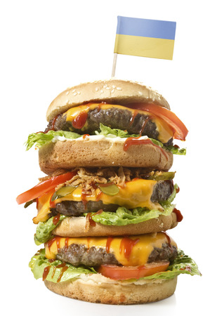 Fresh and tasty XXL hamburger with the flag of Ukraine.(series)
