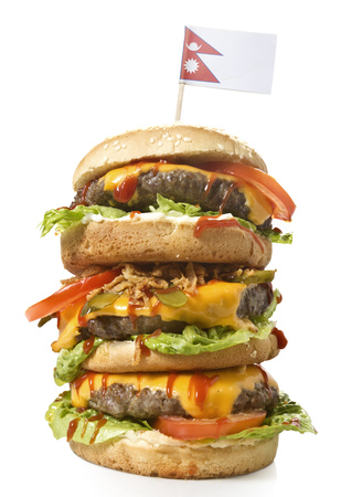 Fresh and tasty XXL hamburger with the flag of Nepal.(series)