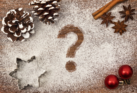 Festive motif of flour in the shape of a question mark symbol
