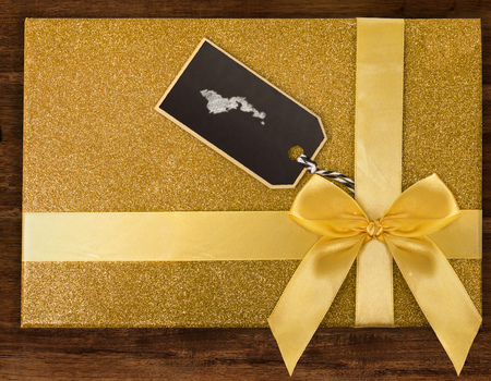 A giftbox with American Samoa drawn with chalk on a blackboard label.(series) Stock Photo