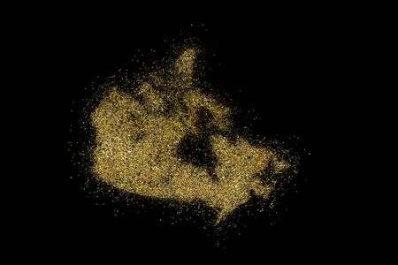 Canada shaped from golden glitter on a black background (series) Stock Photo