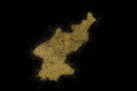 North Korea shaped from golden glitter on a black background (series) Stock Photo
