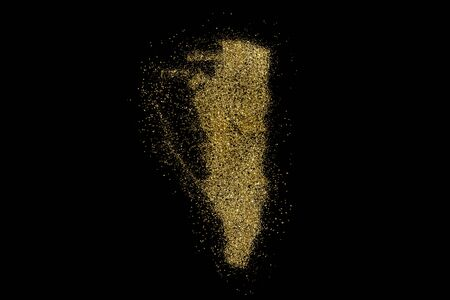 Gibraltar shaped from golden glitter on a black background (series)