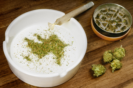 Crumbled weed in the shape of Azerbaijan and a joint. Banco de Imagens