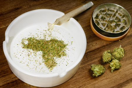 Crumbled weed in the shape of Venezuela and a joint. Banco de Imagens