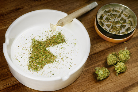Crumbled weed in the shape of Jordan and a joint. Banco de Imagens