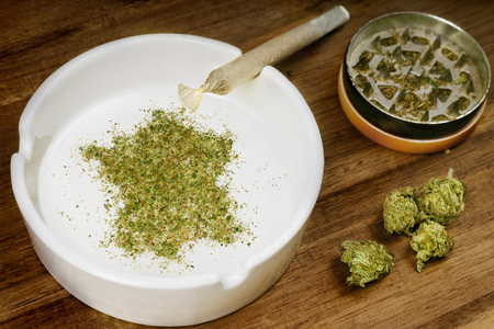 Crumbled weed in the shape of France and a joint. Banco de Imagens