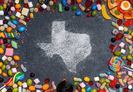 Sugar in the shape of Texas surrounded by a variety of sweets. (series)