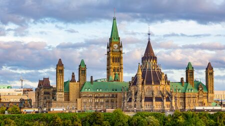 Parliament Hill in Canadas capital city of Ottawa is viewed from the Ottawa river, towards Quebec. Stock fotó