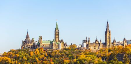 A view of Parliament Hill in Ottawa, Canada from the West shows the famous landmarks at this historic site, including the library and Peace Tower of Centre Block and Mackenzie Tower of West Block.