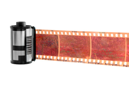 Old photographic 35 mm film with roll. Isolated on white background.