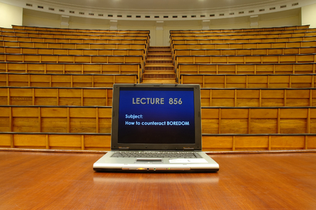Laptop in traditional lecture hall at university