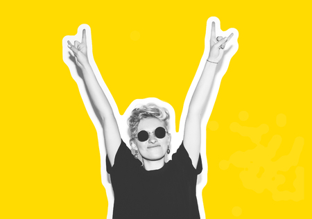 Stylish fashion blonde with short hair colorful collage. Crazy girl in a black t-shirt and rock sunglasses scream holding her head. Rocky emotional woman. white toned. yellow background, not isolated