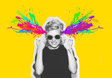 unsafe: Magazine style collage headshot portrait of rocky emotional woman blow mind with finger gun gesture, brain explosion of colors. Mind brain blowing concept. Fun fashion blonde girl in rock sunglasses. Stock Photo