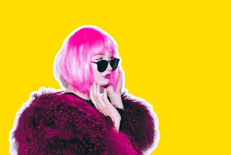 Acid crazy hot beautiful rock Girl in bright pink wig and sunglasses in lama leather swag style red fur winter coat. Dangerous rocky tired of party bored woman Ironically having fun. Stock Photo