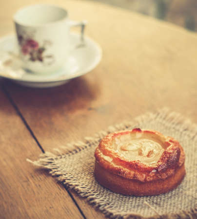 Dessert and vintage tea cup on an old wooden table, retro filtre, slow life and calm lifestyle concept