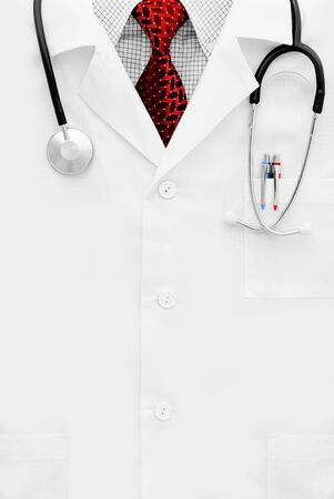 Doctor in red tie with stethoscope shot with space for text Stock Photo - 15148322