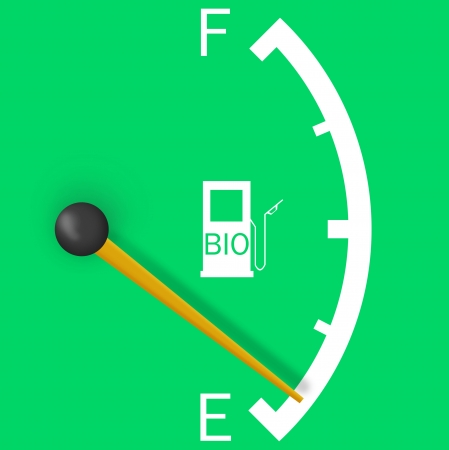 Low fuel sign isolated on a bright green background