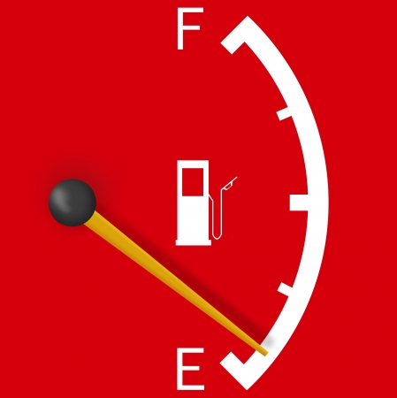 Low fuel sign isolated on a bright red background