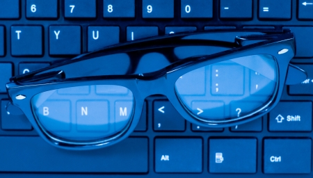 Glasses on laptop computer keyboard  photo