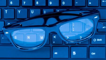 Glasses on laptop computer keyboard