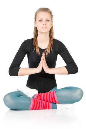 Meditating caucasian female model isolated on white background in full body  Stock Photo