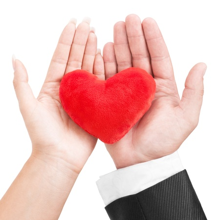 hands holding heart: Heart in the hands of a couple isolated on white