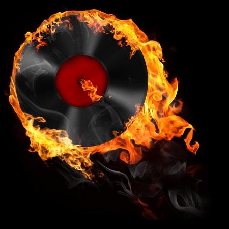 Ilustración del disco de vinilo analógico en el fuego sobre el fondo negro Foto de archivo - 16415362
