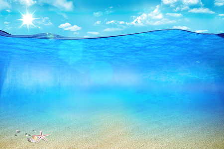 Wonderful picture under and above ocean waters Stock Photo