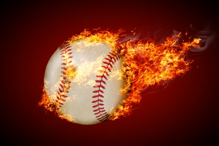 Flying baseball ball on fire Stock Photo