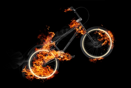 Bike in fire on black background