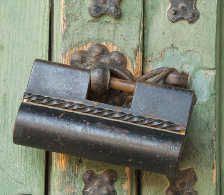 Traditional Korean lock hanging on the door photo