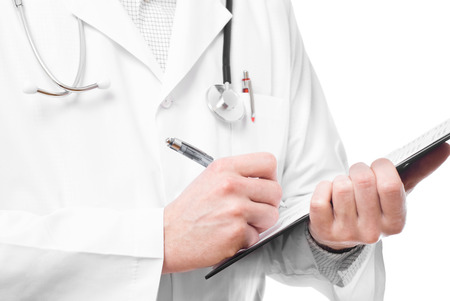 Doctor making notes on clipboard studio shot Stock Photo