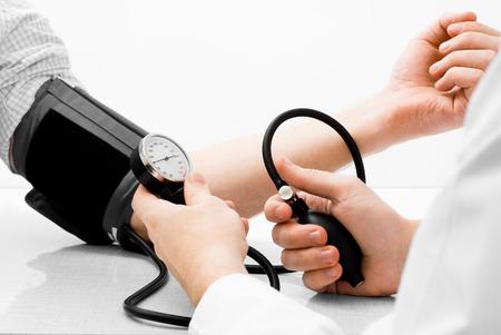 Blood pressure measuring studio shot on white background Stock Photo