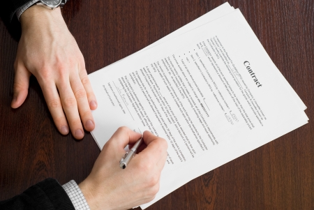Business man signing contract