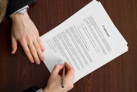 Signing contract by young businessman Stock Photo